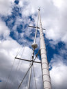 Sails and mast of a modern sail boat with radar boating sailing background Stock Images