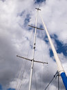 Sails and mast of a modern sail boat with radar boating sailing background Royalty Free Stock Photography
