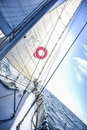 Sails on a sailboat at sea in the north of summer. Royalty Free Stock Photo