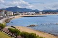 Saint jean de luz beach in pays basque france and pyrenees mountains Stock Images