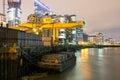 Saint Katherine docks at night with River Thames Royalty Free Stock Photo