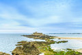 Saint malo beach fort national rocks low tide brittany france europe Stock Image