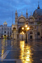 Saint marks square in the rain basilica and clock tower at Royalty Free Stock Photo