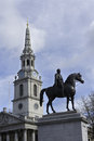 Saint martin in the fields church christopher wren s with king george iv statue foreground trafalgar square london uk Stock Photo