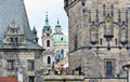 Saint nicholas church and the towers of the charles bridge at lesser town side prague czech republic Stock Photos