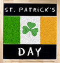 Saint Patrick s Day and Irish Flag on Blackboard Stock Images