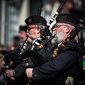 Saint patrick s day parade morristown nj march senior bagpiper dressed in irish soldier uniform at the festival on march in Stock Image