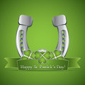 Saint patrick s day st ribbon and a horse shoe Stock Photography