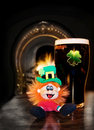 Saint Patrick's Leprechaun with black Irish beer Stock Photos