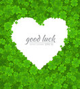 Saint Patricks Day vector design element. Empty white heart on lucky clover or shamrock background