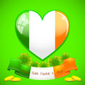 Saint patricks heart of irish flag with ribbon and golden coins Royalty Free Stock Image