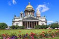 Saint petersburg isaac cathedral beautiful in russia and flowers on the square in front of it Stock Photos