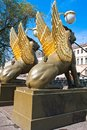 Saint petersburg winged lion sculptures on bank bridge in st russia Royalty Free Stock Images