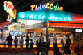 Saint raphael france aug holiday makers wait for home made ice cream at the popular ice cream parlour pinocchio in provencal Stock Images