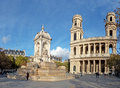 Saint sulpice cathedral in the city of paris france people visiting and fountain europe Stock Photos