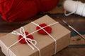 Saint Valentine decoration: handmade crochet red heart on gift p Royalty Free Stock Photo