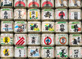 Sake barrels in japanese shrine colorful and famous front of shrines Royalty Free Stock Photos