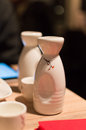 Sake cups and stone bottles with shallow depth of field Stock Images