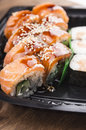 Sake sushi with salmon inside out in plastic Royalty Free Stock Image