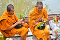Sakonnakhon thailand july buddhist monk is the alms on morning at yam river floating market on in Royalty Free Stock Image