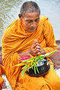 Sakonnakhon thailand july buddhist monk is the alms on morning at yam river floating market on in Royalty Free Stock Photo