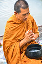 Sakonnakhon thailand july buddhist monk is the alms on morning at yam river floating market on in Stock Photography
