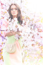 Sakura young brunette lady in flowers of Stock Photos