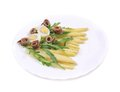 Salad with anchovies and asparagus on a white background Stock Photography