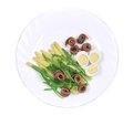 Salad with anchovies and asparagus on a white plate Stock Image