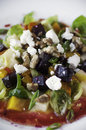 Salad appetizer with golden and purple beets brussels sprout petals pear candied walnuts and goat cheese Stock Photography