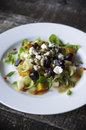 Salad appetizer with golden and purple beets brussels sprout petals pear candied walnuts and goat cheese Royalty Free Stock Photo