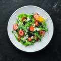 Salad. Salad of arugula, blue cheese, strawberries and blueberries. Royalty Free Stock Photo