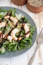 Salad with arugula, shrimps, parmesan cheese and pine nuts Royalty Free Stock Photo