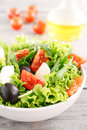 Salad with arugula, tomatoes, black olives, lettuce with mozzare Royalty Free Stock Photo