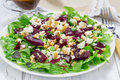 Salad with beets feta cheese and walnuts dressed balsamic sauce Royalty Free Stock Photo