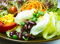 Salad on brown plate Royalty Free Stock Photography