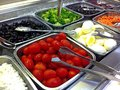 Salad buffet a or bar with numerous vegetables including carrots broccoli black olives tomatoes cottage cheese and other Stock Photography