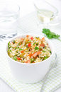 Salad with bulgur zucchini tomatoes chili peppers bowl of and parsley Stock Images