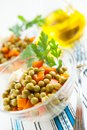 Salad with canned green peas and boiled vegetables Stock Images