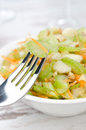 Salad with celery, carrots and apples in a white bowl, closeup Stock Photos