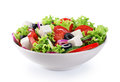 Salad with cheese and fresh vegetables isolated on white backgro Royalty Free Stock Photo