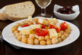 Salad with chick-pea on the plate with olives Royalty Free Stock Photos