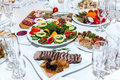 Salad and cold meats at the banquet table a Royalty Free Stock Image