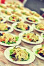 Salad dishes manu served for group of people one in focus rest of them in blur Stock Image