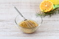 Salad dressing with olive oil honey lemon and mustard in a bowl Royalty Free Stock Images