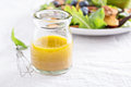 Salad dressing with olive oil and vinegar Royalty Free Stock Photo
