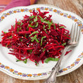 Salad of fresh beets and carrots with parsley closeup Royalty Free Stock Photography