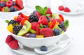 Salad of fresh fruit and berries in a bowl white cup tea the background horizontal Stock Photos