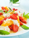 Salad fresh with fruits berries and cottage cheese shallow dof Stock Image