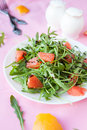 Salad of fresh greens and slices of grapefruit closeup Stock Photos